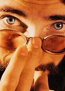 Close up image of caucasian/european man looking over the top of his glasses (thumbnail)