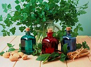 Aromatherapy  oils.    Bottled  aromatherapy  oils surrounded by herbs,  clockwise from top: parsley, cinnamon, bay, mint and almonds. In aromatherapy...