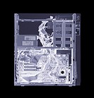 Computer.    Simulated   X-ray   of   a   vertical processing  unit  of a computer.  The front of the unit (right) contains removable  disc  drives  f...