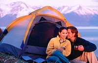 Couple at camp above Turnagain Arm. Chugach State Park. Alaska