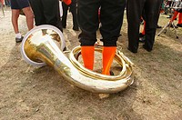 Man wearing orange socks with tuba. Hamilton, Ontario. Canada