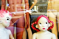 Mannequins of little girl and little boy in storefront. Paris. France