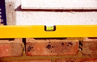 Spirit level on brick wall