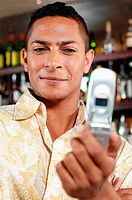 Man holding cellular telephone