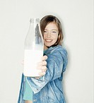 Teenager, jeans clothing, milk bottle