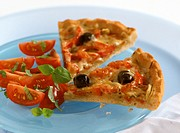 Two pieces of tomato and pepper pizza with olives