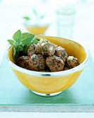 Lamb meatballs, minted yoghurt sauce & glass of water behind