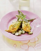 Stuffed courgette flowers on steamed courgette slices (1)