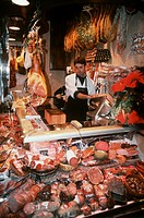 Sausage & ham specialities in counter display of butcher´s shop