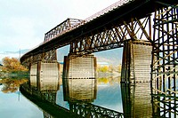 Old railroad bridge with reflections in the water. Kamloops. British Columbia, Canada