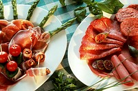 Ham platter with asparagus, sausage platter with caper apples