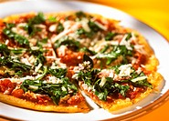 Tomato pizza with salami, rocket and Parmesan (1)