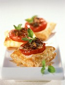Tomato and cheese snacks on puff pastry