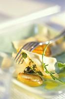 Fish ravioli with herbs and onions