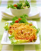 Pasta and ham pancake with salad