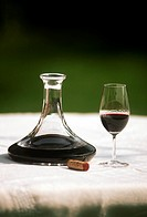 A glass and a carafe of port