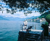 Older couple in park bench overlooking Lake Como. Bellagio. Lombardia. Italy