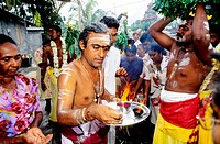 Tamil people performing hinduist ritual at St-Gilles-Les Hauts. Reunion Island (France)