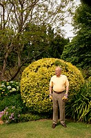 Older man standing in garden