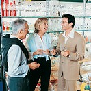 Mature Couple Asking for Help From a Shop Assistant in a Crockery Shop