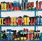 Variety of Wellington Boots in a Line on Shelving