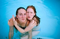 Two girlfriends in swimming pool