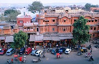Storefronts, traffic in old city (Pink City). Jaipur. Rajasthan. India.