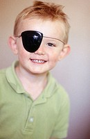 4 year old boy wearing pirate eye patch