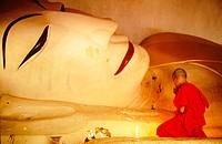 Novice monk praying buddha. Bagan. Myanmar (Burma)