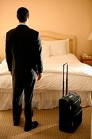 Businessman standing in hotel room