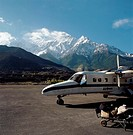 An aeroplane on a runway in a mountainous region (thumbnail)