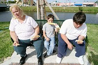 Overweight family eating at Springs River Festival, Miami Springs. Florida, USA