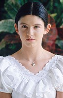 Young hispanic girl wearing white blouse
