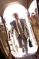 Businessman Entering Airplane