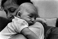 Woman Holding Baby on Shoulder