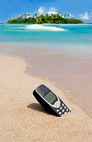 cell phone in sand