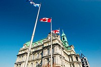 The Quebec, Canadian and Montreal City flags outside the Montreal City Hall (Hotel de Ville) near Place Jacques Cartier in Old Montreal (Vieux Montrea...