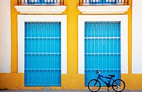 Bicycle in front of colourful Havana building. Cuba