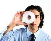 A young businessman holds a CD to his face looking at the viewer through the hole