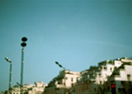 Street lamps and apartment buildings, blurred