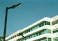Apartment building and street lamp, low angle view, blurred