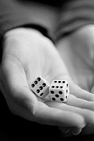 Close-up of open hand holding a pair of dice