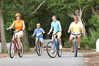 A family of four riding bicycles