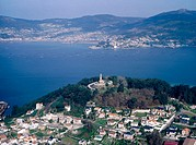 Aerial view of Vigo with chapel and Vigo's estuary. Pontevedra province. Galicia. Spain