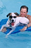 man with funny dog in the pool