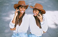 Columbian identical twins on cell phone