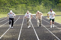 Males run the 100 yard dash at Senior Olympics. St. Clair County, Michigan, USA