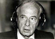 Portrait of Yitzhak Rabin wearing headphones