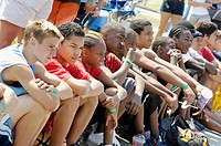 Middle school age teams watch and wait to participate in basketball tournament