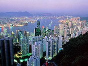 Hong Kong at dawn. View across Hong Kong at dawn as the lights of the city still shine. In the foreground is Central District on Hong Kong Island, in ...